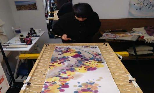 Cristina pintando en directo en dLana